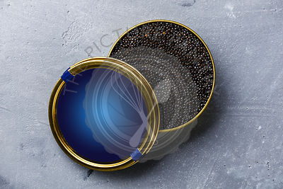 Black Sturgeon caviar in can on concrete background