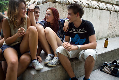 Italy - Verona - Teenagers sit by the fountain in the Piazza Independenza