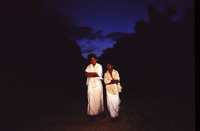 India - Kerala - Boys having woken at dawn for their dance class walk to their ablutions