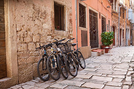 Bicycles on a stone street in Rovinj, Croatia.