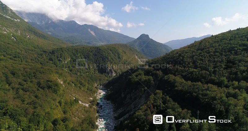Mountain rapids, C4K aerial drone view over a turquoise soca river, in the alpine nature, near Trigolov national park, on a sunny summer day, in the Julian alps, Slovenia