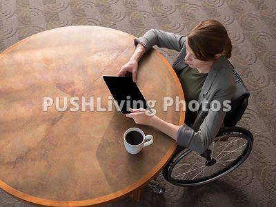 Young business woman in a wheelchair