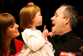 Snooker - Betfred.com World Snooker Championship - The Crucible Theatre, Sheffield - 2/5/11.John Higgins celebrates with daughter Claudia and wife Denise after winning the World Snooker Championship.Mandatory Credit: Action Images / Steven Paston.Livepic