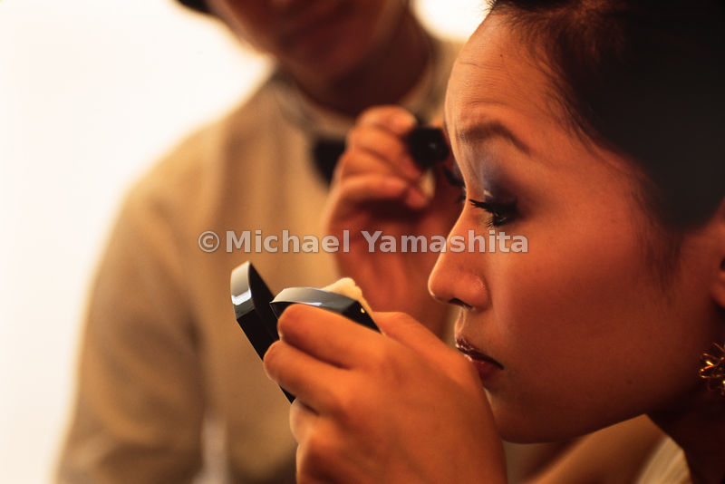 A bride has her hair and special make up done at Venus wedding studio in Shanghai, China.