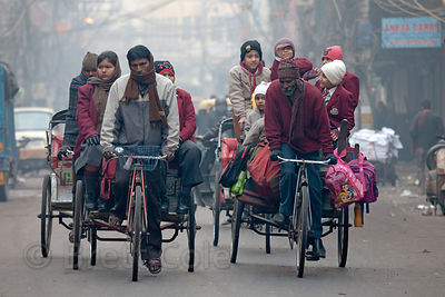 Children are driven to school in rickshaws in the Chandi Chowk area of Old Delhi, India