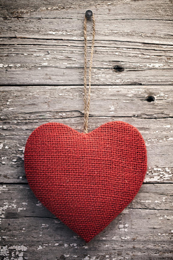 Red burlap heart on vintage table