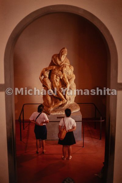 People examine sculptures that were created for the Cattedrale di Santa Maria del Fiore in the Museo dell'Opera del Duomo. Florence, Italy, 1988.