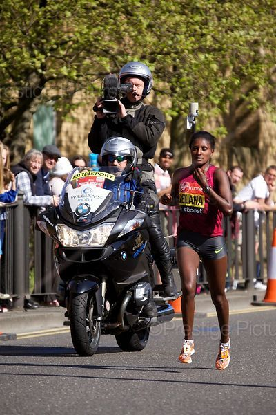 Tiki Gelana (9th) of Ethiopia Running in the  Elite Womens Event at the 2014 Virgin London Marathon with a BBC Sport Camera Bike Following
