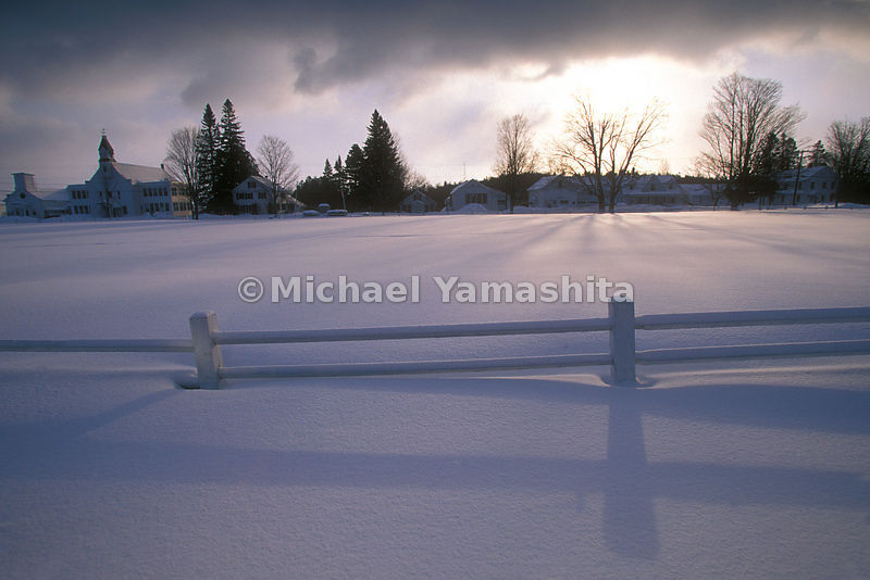 A fence covered with snow in Craftsbury Common,Vermont