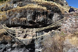 New foundation ropes in position across the canyon, Q'eswachaka , Canas province , Peru