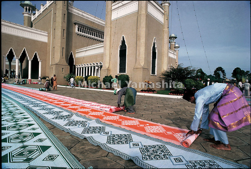 Woven mats are rolled out in preparation for Friday prayers at Saifuddien Mosque in Bandar Seri Begawan.