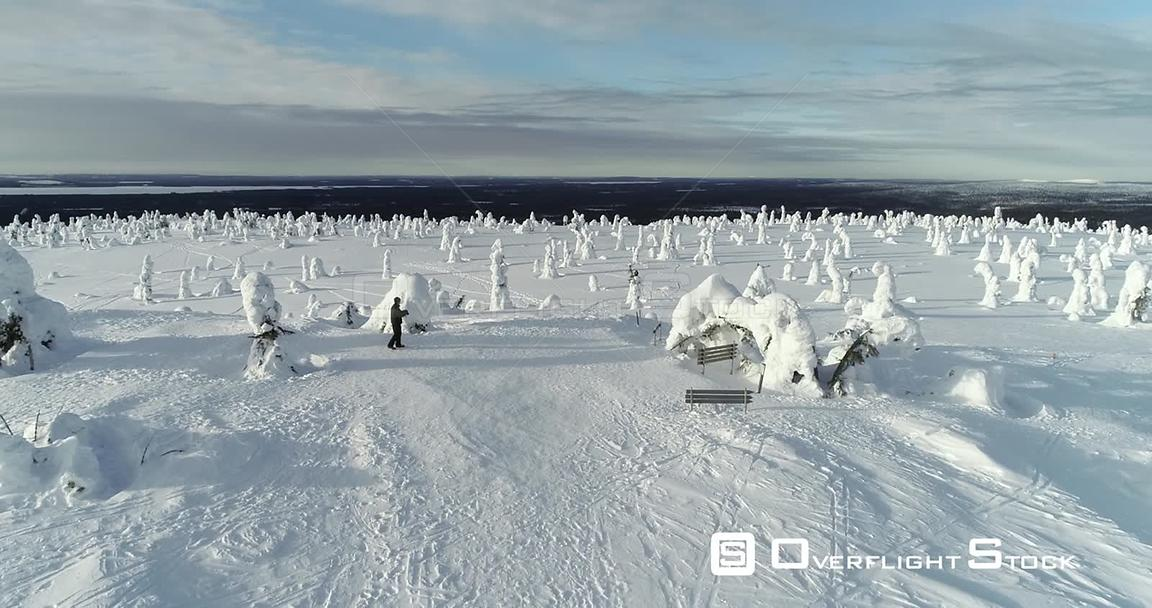 Man Hiking, Snowy Mountain, 4k Aerial View of a Male Taking Photos on the Top of a Fjeld Tunturi, Full of Snow Covered Trees, Riisitunturi National Park, Lapland, Finland