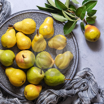 Yellow and green organic pears.