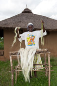 Kenyan lady holding up strands of Sisal ready to make into rope to sell at the market.