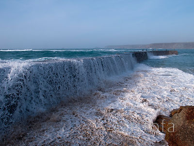 wave cascades over Sennen breakwater