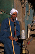Man smoking a water pipe or Sheesha,  Cairo, Egypt