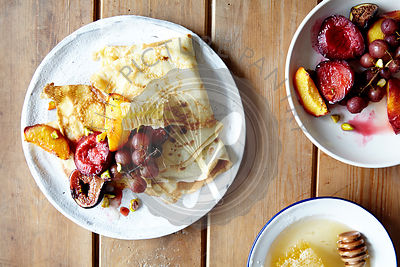 Crepes with roasted fruit and honeycomb