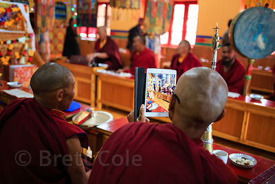 A monk takes a photo with his iPad in Matho Gompa, Ladakh, India