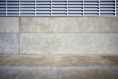 Concrete wall with metal window.