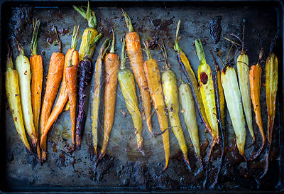 Rainbow carrots roasted on a pan.