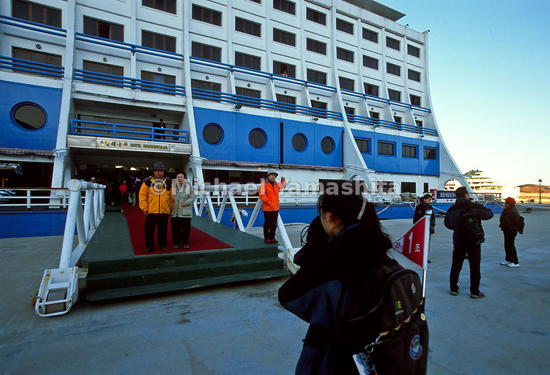 People taking photos outside of Jaegumgang floating hotel. North Korea.