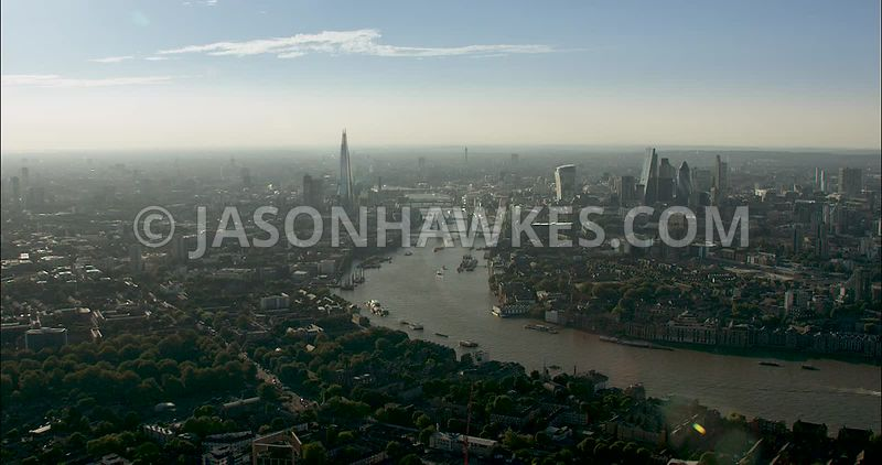 London Aerial Footage of River Thames at Bermondsey towards city skyline.