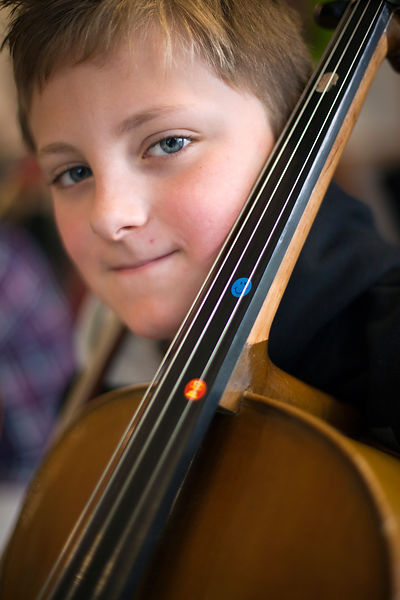 UK - Scunthorpe - A boy, part of the Youth Concert Band practices his cello during rehearsals of Cycle Song at the John Leggot Centre