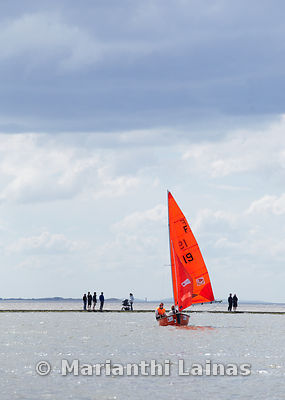 Red sailing boat