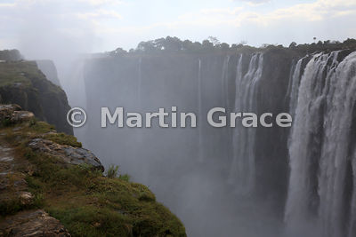 Victoria Falls being The Smoke That Thunders, looking west along the First Gorge, Zimbabwe and Zambia