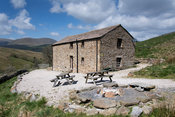 Old traditional field barn in Yorkshire Dales converted into a holiday bunk barn, Cumbria, UK.