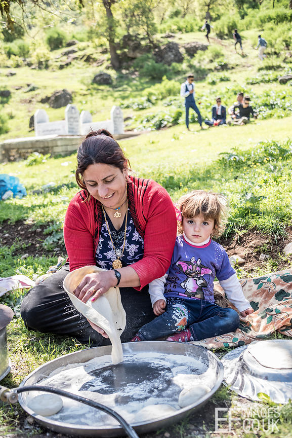 Making bread for a Red Wednesday family picnic in the mountains of Lalish for Yezidi New Year. Iraqi Kurdistan, 19th April 2017
