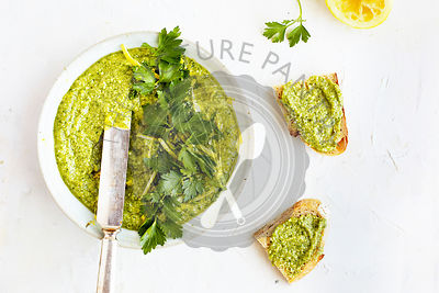 Italian Parsley Lemon Pesto served in a ceramic bowl with sourdough bread