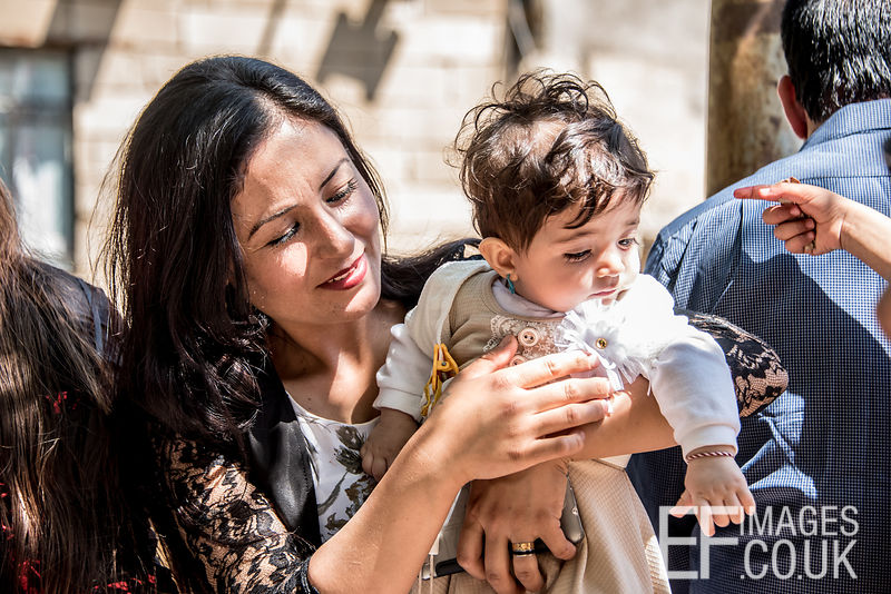 A Yezidi Woman With Her Baby Girl At Red Wednesday, Or Yezidi New Year, Celebrations In Lalish, Iraq. 19th April 2017