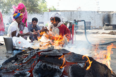 Hindus prepare roti at a day of observance for deceased relatives (not Mahalaya, something else, but I don't remember the name), Pushkar, Rajasthan, India