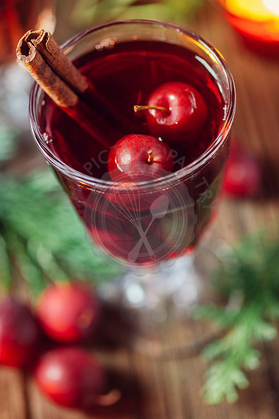 Hot mulled wine with small crab apples