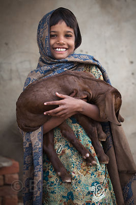 Girl and her goat from the rural village of Kharekhari, Rajasthan, India