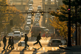 A local running across Seneca street in Seattle, Washington on a bright sunny day.