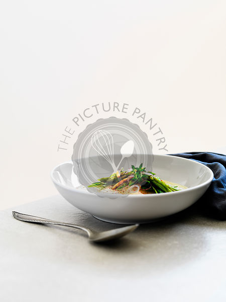 White turnip soup with asparagus and pine nuts