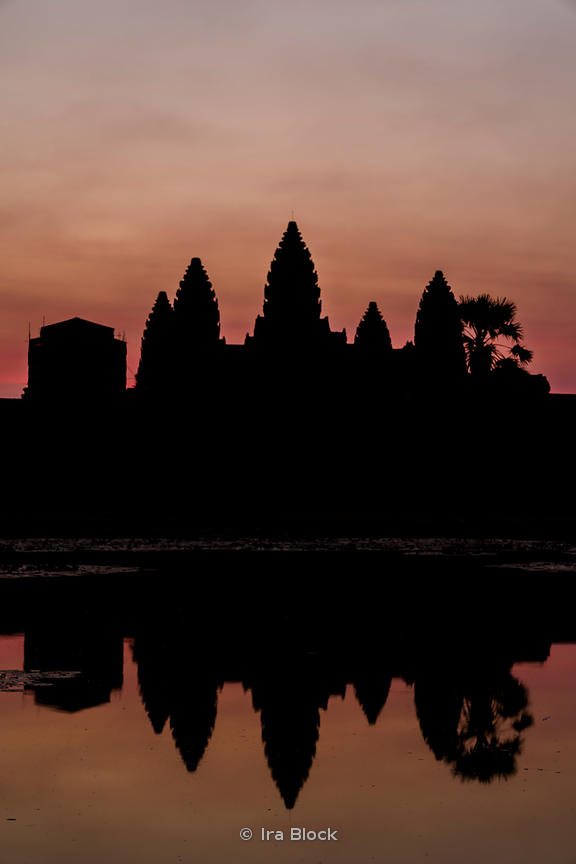 A view of Angkor Wat at dawn. Angkor Wat was built by the Khmer King Suryavarman II in the early 12th century in Siem Reap, Cambodia. It was first a Hindu and later a Buddhist temple.