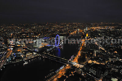 Night aerial view over Charring Cross, River Thames, London Eye and Westminster