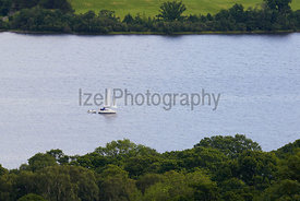 A yacht sailing on Ullswater in the English Lake District. UK.