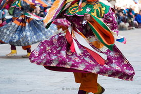 Traditional mask dance at the festival in Punakha Dzong, Bhutan.