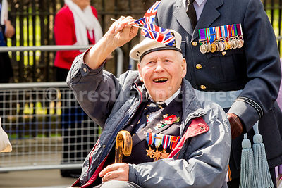 Old Soldier waves and Smiles Broadly