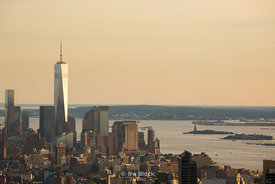 Statue of Liberty and Freedom Tower, One World Trade Center from Top of the Rock in NY.
