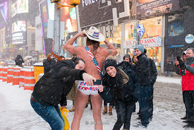 Naked Cowboy at Times Square during a snow storm in New York, USA.