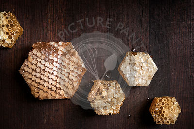 Large pieces of fresh honeycomb cut into hexagon shapes.