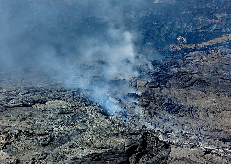 Aerial view of solidified lava and steam from the  Erta ale volcano (the smoking mountain) in the Afar desert, Northern Ethiopia, February 2009