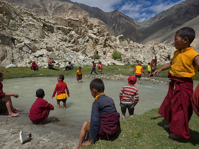 This photograph of young buddhist monks playing, was taken in Ladakh.