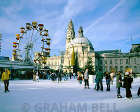 ice skating at cardiff winter wonderland with the city hall in the background