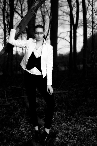 Fashion shoot with Anete Lusina in the woods. The style is a business one but with a make up mask. MUA Natalie Greenwell